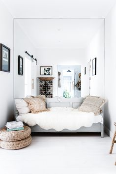 <b>Entry</b> The antique daybed is paired with organic textiles. The mirror visually expands the space and reflects light. <i>Styling by Hande Renshaw and photography by Maree Homer</i>.