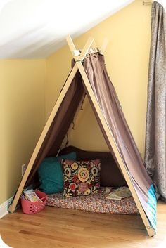 Tent made from wood pieces & curtains!