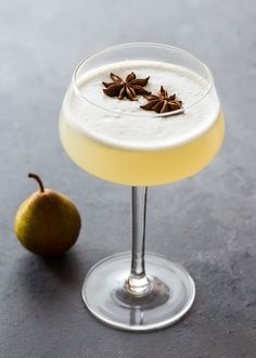 Spiced Pear Gin Fizz is a refreshing cocktail with the warm flavors of star anise and cardamom.