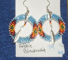 Unique hand beaded earrings with silver metal feathers. Native American made $25.00 w/ free shipping within USA. #earrings #beadwork #nativeamerican