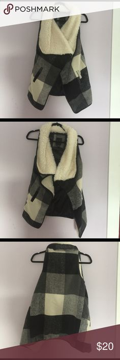 Trendy black and white buffalo plaid vest Open front faux Sherpa vest with a black and white buffalo plaid print. I bought it from another posher for an event but didn't end up wearing it. This vest is so soft and comfortable! Great for a comfy chic look me jane Jackets & Coats Vests