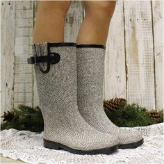 Herringbone grey rain boots. Stay dry and look fabulous wearing our herringbone tall rubber rain boots. Cute look with black side buckle. The perfect fashion rain boot boot for all weather. Go find a