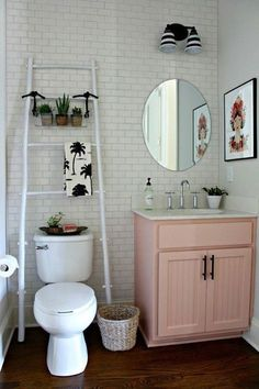 love the euro feel | scandi bathroom | pink vanity | upcycled | small bathroom | white subway tile | plants and greenery