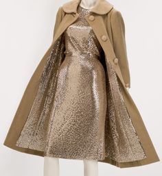 """Norman Norell's signature evening gowns were known as """"mermaid dresses."""" Sparkling and form-fitting, the dresses debuted in the early 1940s and were a highlight of every Norell collection until his last in 1972. The individually hand stitched sequins were sewn twice to assure that they lay flat and would not catch on one another. This was particularly important for this custom-made ensemble because both the dress and the lining of the coat are entirely covered with sequins."""