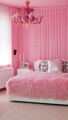 This bedroom reminds me of my bedroom.I love the color pink.It is just eye catching.I am so glad I pinned it.