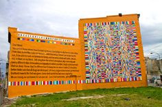 """""""The Color of Your Voice"""" by Keir Johnston and Ernel Martinez: """"the artists used poetry generated in workshops...designated a single color per letter and translated all the poetry into colors. The translated mural also uses pieces of trash to signify colors—many of the green lines are Sprite cans. The artists were inspired by going into the corner store and seeing displays of colorful bags of snacks."""" Part of Philly Mural Arts Program"""