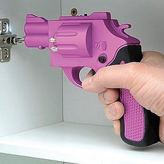how cool is this ... a Revolver Shaped Rechargeable Screwdriver With Drill Bits