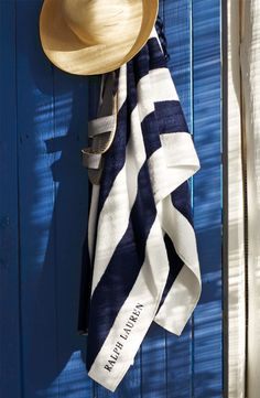 Beach day essentials: soft, striped Ralph Lauren Home towel, chic sun hat and barely there sandals