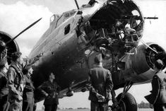 Two shots from a B-17 from the 379th Bomb Group with most of the nose missing [via] On the second one it seems the Pilot is looking up at the damage