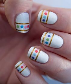 White gloss nails with gold nail art tape used to create a dropped smile line and colorful dots Free Hand Nail Art  Fantastic idea to do a Rainbow or Gay Pride Mani