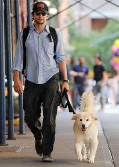 Actor Bradley Cooper takes his rescued chow-retriever mix, Charlotte, for a walk in Tribeca, New York. The star has a large portrait of his deceased pooch, a short hair Pointer named Samson, hanging up in his home.