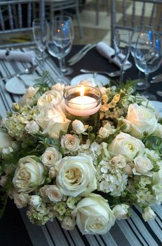 Gill, another circular table centre but with a single floating candle vase, I can hire these at per vase including the candle if you like the look of this rather than a hurricane vase Candle Centerpieces, Wedding Table Centerpieces, Floral Centerpieces, Wedding Decorations, Table Decorations, Candles, Wedding Reception Flowers, Floral Wedding, Table Arrangements