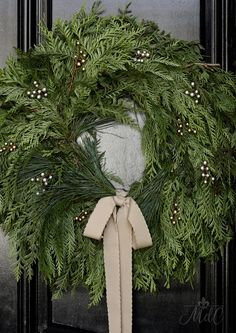 A French inspired Christmas front porch, decorated with natural greens and neutrals, brings holiday cheer to your guests as they walk through the door. Front Door Christmas Decorations, Blue Christmas Decor, Classy Christmas, Minimal Christmas, Christmas Porch, Noel Christmas, Merry Little Christmas, Rustic Christmas, Winter Christmas