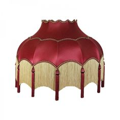 <p>  Striking scalloped lampshade in wine with fringe and tassel detail.</p> <p>  These ornate period shades are all handmade in England. Their quality is flawless and these shades have featured in a number of television period drama programmes including Downton Abbey. They are particularly suited to standard/floor lamps.They are available in a wide variety of fabrics, beading and fringing so a more bespoke shade can be made to order if required. Please call us on ...