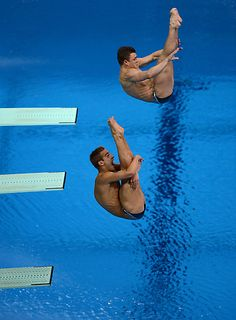 USA's Kristian Ipsen, dives with Troy Dumais, for their third of six dives for the Men's Synchronized 3m Springboard where they won bronze
