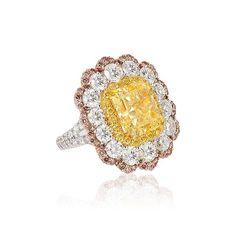 David Mor Jewelry A Sensational 8 carat fancy yellow diamond! Beautifully encircled by pink and white diamonds.
