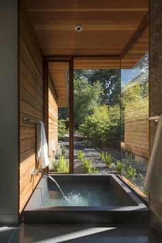 Midcentury Modern in Northern California An onsen, or Japanese soaking tub, with a private garden abuts the master suite.Modern Times Modern Times may refer to modern history. Modern Times may also refer to: Japanese Soaking Tubs, Japanese Bathroom, Japanese Shower, Japanese Soaker Tub, Midcentury Modern, Rustic Modern, Rustic Wood, Modern Japanese Interior, Japanese Modern House