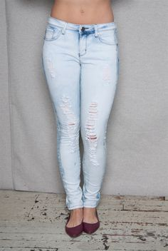 Only the jeans need to suffer for your hot urban style with these light blue bleach-wash skinny jeans Light slashes and fraying in the front and a bleach-wash finish creates instant edginess to your look while stretch denim and super-slim cut keeps this mid-rise jeans fully feminine and sexy