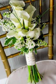 Hand tied bouquet, featuring white callas and lilac....love the style of this boquet