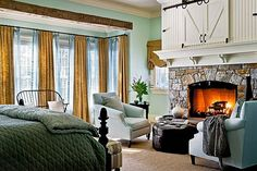 How warm and cozy! Notice the beam and the TV nook above the fireplace.