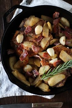 Roasted Pork Chops with cider-spiced apples, bacon, roasted garlic, and rosemary #paleo