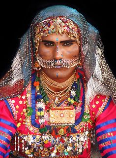 Portrait of a male dance performer from desert Cholistan wearing traditional cloth and jewelry common to the region, Rohi, Pakistan, photograph by Awais Yaqub. Cultures Du Monde, World Cultures, We Are The World, People Around The World, Folklore, Photo Portrait, Folk Costume, Costumes, Tribal Costume