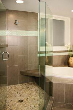 Glass shower doors open up the room