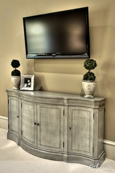 TV Console @Kristi Fulton-Hayden why don't you use your entry way piece or dining room buffet thing for this??