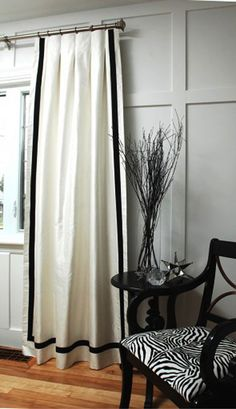 lengthen drapes, border around entire panel panels- both the wall ones and the window