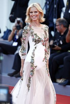 Sheer delight: The 43-year-old model wowed in a dramatic see-through gown