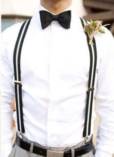 This braces and bow tie look is great for your groom. #wedding #groom