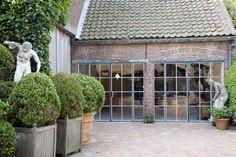 boxwood planters & awesome garage doors!