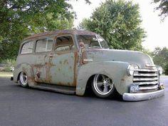 Chevy Advanced Design Suburban slammed over five spoke wheels.
