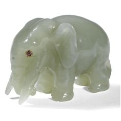 A FABERGÉ CARVED BOWENITE MODEL OF AN ELEPHANT, CIRCA 1900 realistically and humorously modelled, the eyes set with rubies