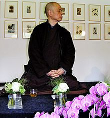 "Thích Nhất Hạnh-- (born as Nguyen Xuan Bao  on October 11, 1926) is a Vietnamese Buddhist monk and peace activist. He lives in Plum Village in the Dordogne region in the south of France,[2] travelling internationally to give retreats and talks. He coined the term ""Engaged Buddhism"" in his book Vietnam: Lotus in a Sea of Fire. A long-term exile, he was given permission to make his first return trip to Vietnam in 2005."