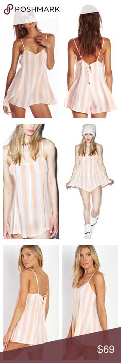 """Wildfox beach striped romper Feminine cover up romper featuring flowing shorts finished by a flared hem. Adjustable straps. Fabric: 100% Rayon Care: Wash cold. Size and Fit: Model is in size S; Model is 5 ft 9. Bust measures 36"""", length 29"""". Wildfox Pants Jumpsuits & Rompers"""
