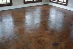 Any Interest in doing a stained concrete in the basement.  This would be easy to clean and there are hundreds of colors to choose from.