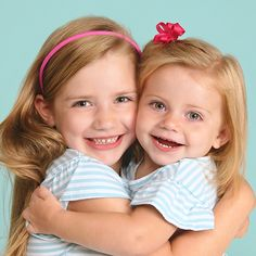 """Say """"I love you"""" in style with this adorable sibling photo idea. Recreate the look with matching shirts and pink & red accents. Sisters by birth but best friends by choice!"""