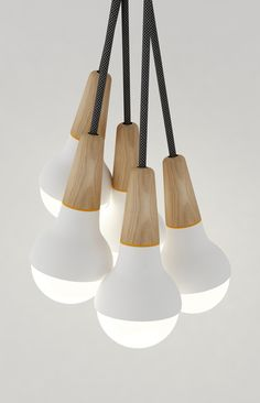 Stephanie Ng Design - Scoop cluster pendant lite - American Oak with powder coated aluminium spun body in white or black.
