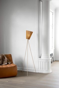 NORTHERN OSLO WOOD FLOOR LAMP Modern without being trendy, this tripod floor lamp has fast become a design-world, and customer, favorite. The upward-facing cloth shade is attached by a gimbal, so it can be rotated in any direction. As the shade points up, it offers a diffuse glow that can be quite effective for providing light even in a large room.