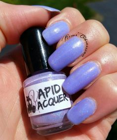 Medium bottle I ordered of PEGASUS POOTS by VAPID LACQUER: light violet (I would even say a lavender) linear holographic crelly polish.  Absolutely stunning in the sunlight.