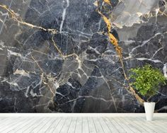 This luxe grey marble with gold detailing wallpaper will add prestige to any room in the home. Available worldwide.  Shop this and more marble wallpaper styles at www.wallsauce.com