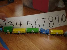 Wooden trains + number stickers - have your preschooler put the cars in order from 1 to My special needs kiddo needed a number line to prompt him, but boy does he love this activity! Eyfs Activities, Number Activities, Alphabet Activities, T Is For Train, Transport Topics, Early Years Teaching, Speech Therapy Autism, September Themes, Reception Class