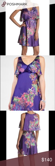 Halston Heritage gorgeous tiered purple dress 8 Purple floral tiered Halston Heritage dress. Ultra flattering. 100% silk. V-neck. Hem hits the knee. Ruffle tier overlay on bodice. Zip closure. Slight flare. Worn once. Original price $395. Halston Heritage Dresses Midi