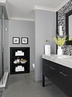What could have been a wasted wall between the toilet and shower was maximized with a recessed set of shelves, trimmed in the same rich wood as the rest of the bathroom for a coordinated look./ like this paint color Bathroom Renos, Basement Bathroom, Bathroom Grey, Modern Bathroom, Bathroom Renovations, Gray And White Bathroom Ideas, Bathroom Makeovers, Master Bathrooms, Bathroom Storage