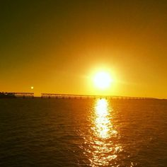 Road-trip from Key West to Miami, #Florida to catch striking sunsets like these over the Bahia Honda Rail Bridge along Highway 1. Photo courtesy of eachapman4 on Instagram.