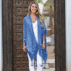 For a wrap that won't weigh you--or your style down, check out our new Annaleise Navy Kimono Scarf.  Color and patterns from our travels to Marrakesh have been splashed onto this versatile accessory that can be worn as a scarf or a kimono.  An engineered jacquard weave gives added texture to this one-size-fits-all scarf that is made from a blend of microfiber, rayon, nylon and wool.  Super soft and lightweight, it drapes beautifully and is accented with cotton braided tassels at the four ...