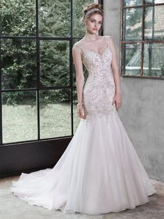 Maggie Sottero - MELISSA, Glittering Swarovski crystals; shimmering pearls and sparkling sequins adorn the intricate bodice of this Chic organza fit and flare wedding dress; softly falling into a flared skirt. Finished with dramatic sweetheart neckline; deep scoop back and crystal buttons over zipper and inner elastic closure.