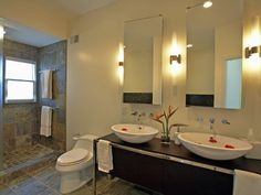 easy-on-the-eye-paint-colors-schemes-bathroom-design-displaying-double-frameless-wall-mirro-between-three-lighting-wall-scone-bulb-with-gold-base-finished-above-dark-brown-mahogany-wood-storage-cabine-938x704.jpg (938×704)