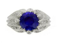 Sapphire and diamond ring, circa 1940. A platinum ring set with one central round old cut unheated Ceylon sapphire in a fancy claw setting with an approximate weight of 3.00 carats, the elongated claws set with thirty round old cut diamonds in bead settings with an approximate total weight of 0.30 carats, and on a tapered ridged shank.